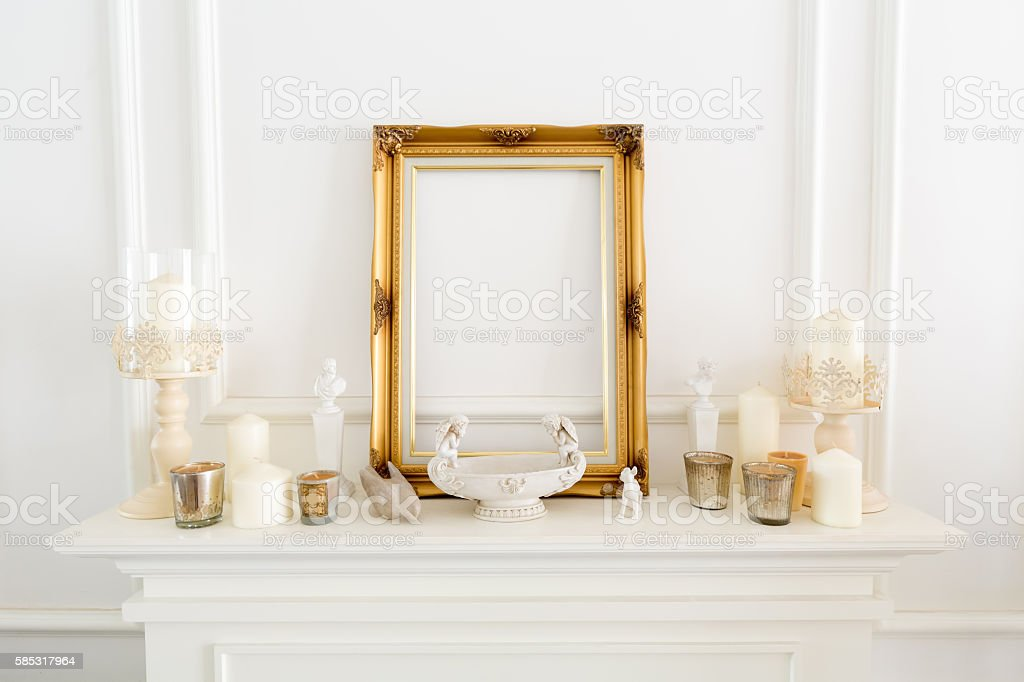 Decoration items placed on top of fireplace stock photo