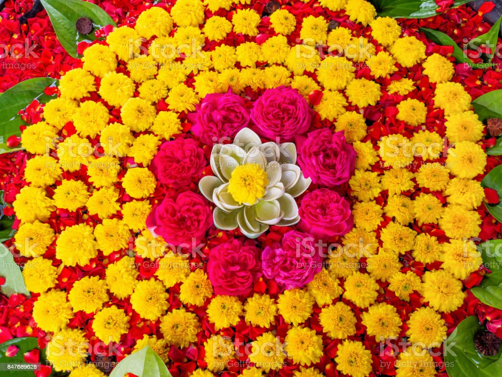 Decoration of  yellow chrysanthemum flowers and red roses stock photo