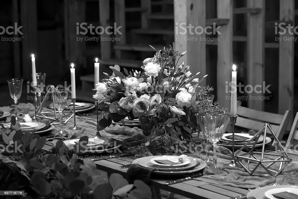 Decoration wedding table before a banquet in a barn. stock photo