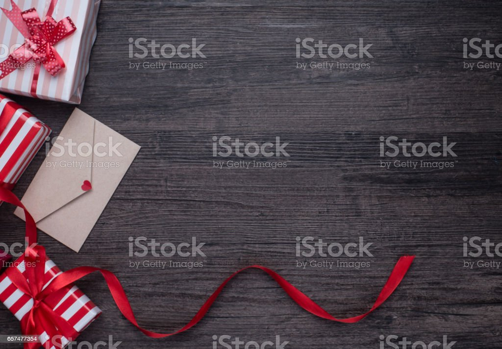 decorations and gift boxes on wooden board stock photo