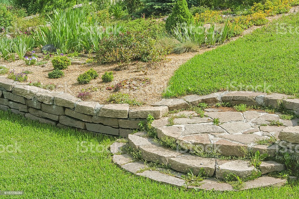 Decorative alpine slide on a green slope stock photo