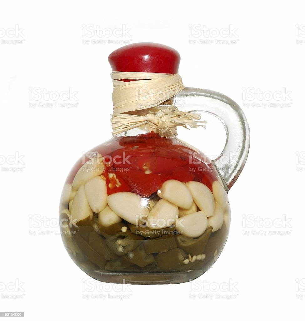 Decorative bottle with sealed vegetables royalty-free stock photo