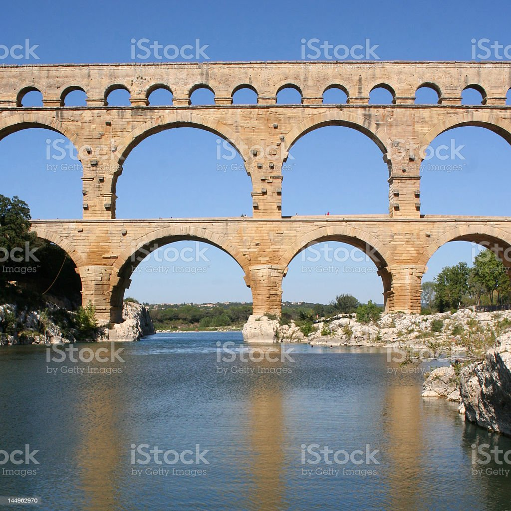 A decorative bridge over water at Pont du Gard stock photo