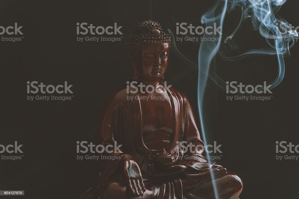 Decorative Buddha statue, Buddha in the background of incense, S stock photo