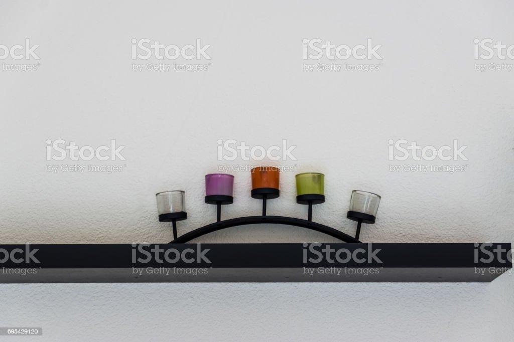 Decorative candle on wooden shelf stock photo