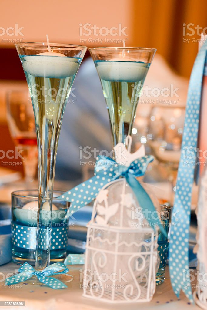 Decorative candles with blue ribands stock photo