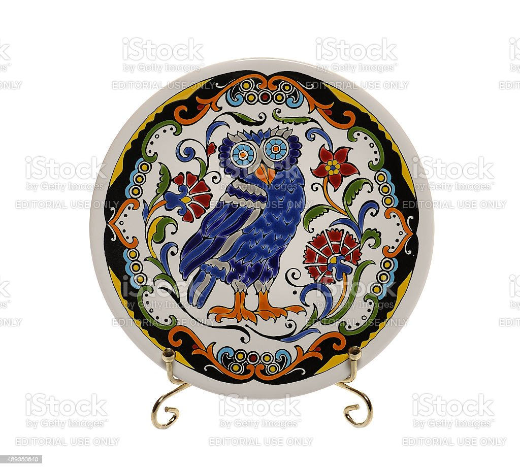 Decorative ceramic saucer with owl and ornament stock photo
