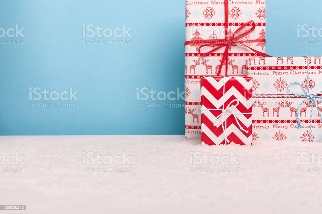 Decorative christmas gifts in snowy scene stock photo