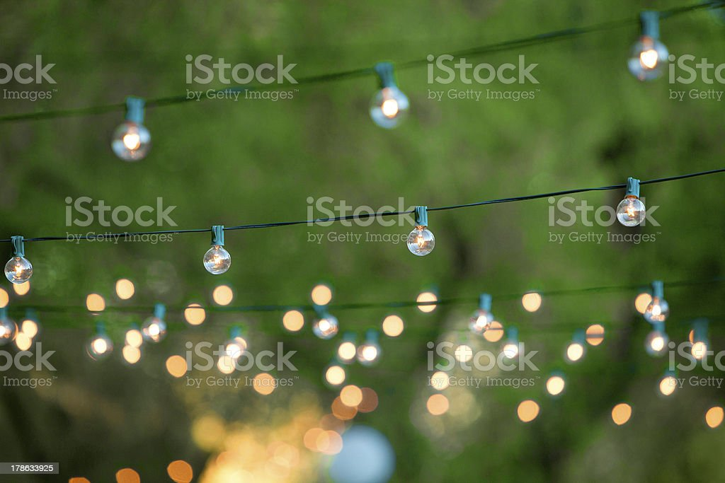 Decorative christmas lights for a back yard party stock photo