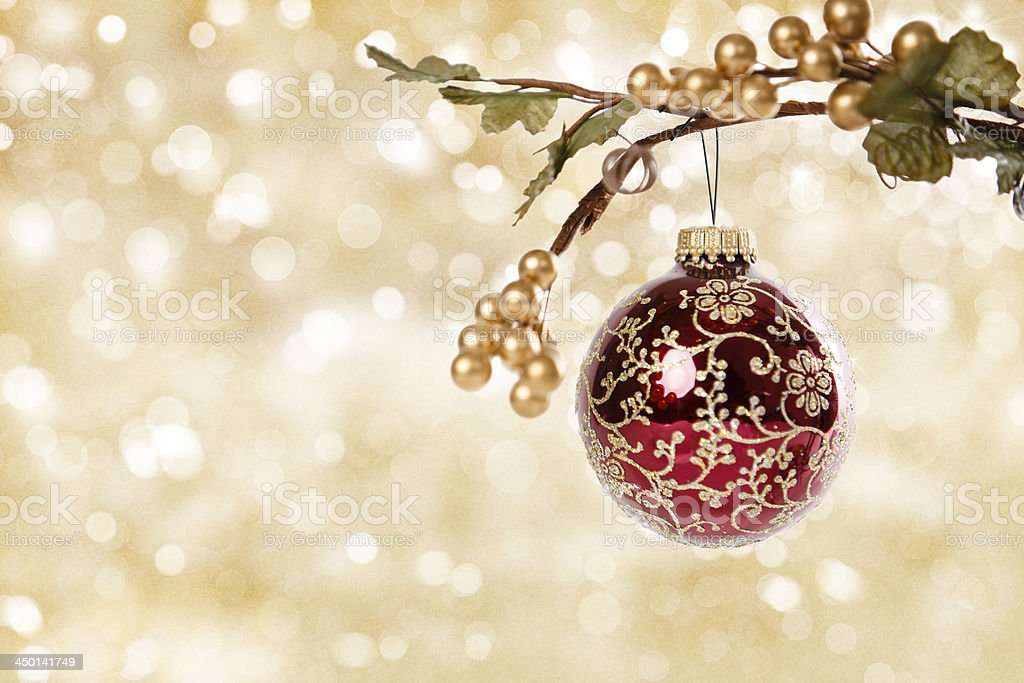 Decorative Christmas Ornament on Gold Background royalty-free stock photo