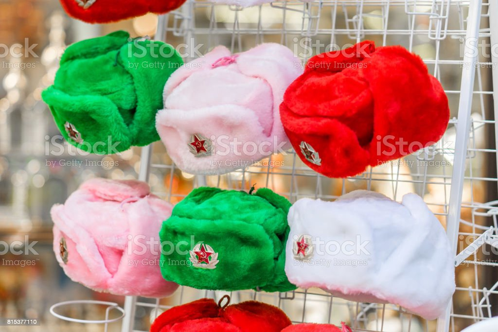 decorative classic Russian winter hats. Souvenirs colorfull stock photo