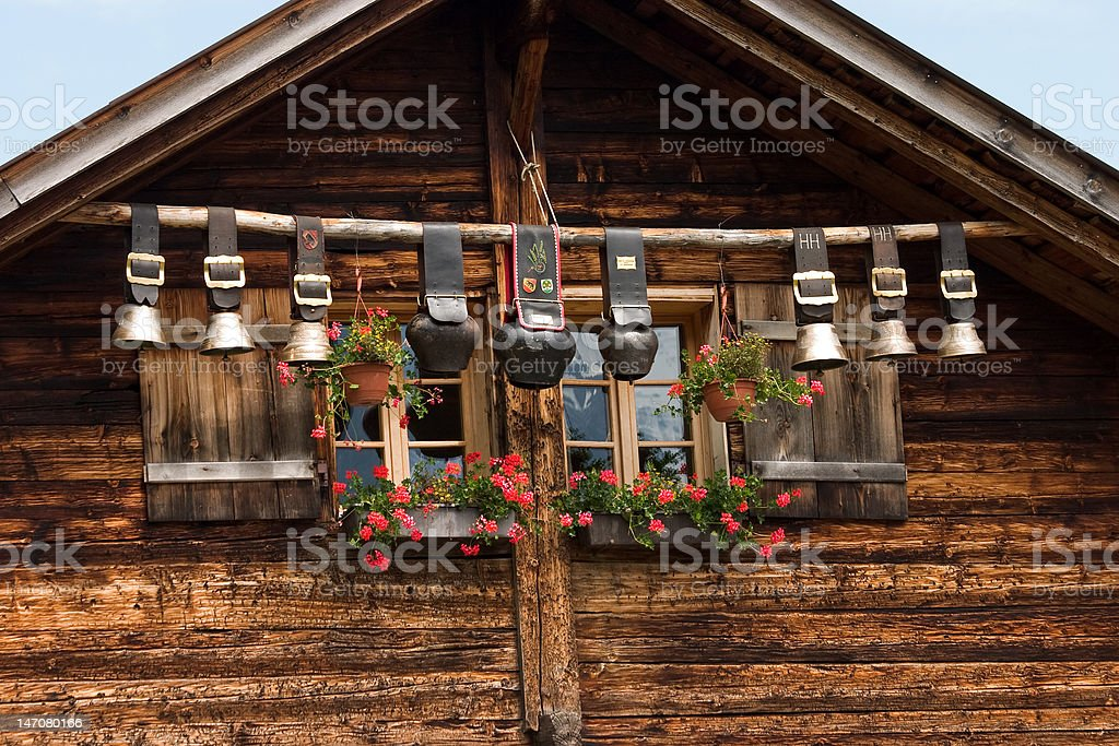 Decorative cow bells under the roof stock photo
