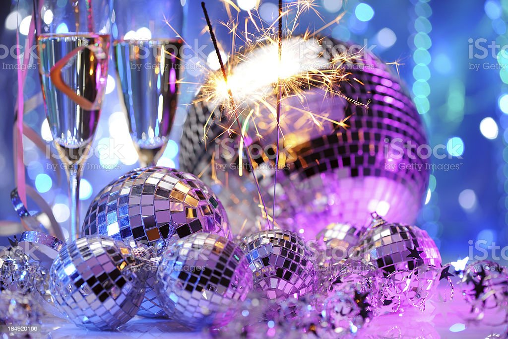 Decorative disco balls and fire sparkler royalty-free stock photo