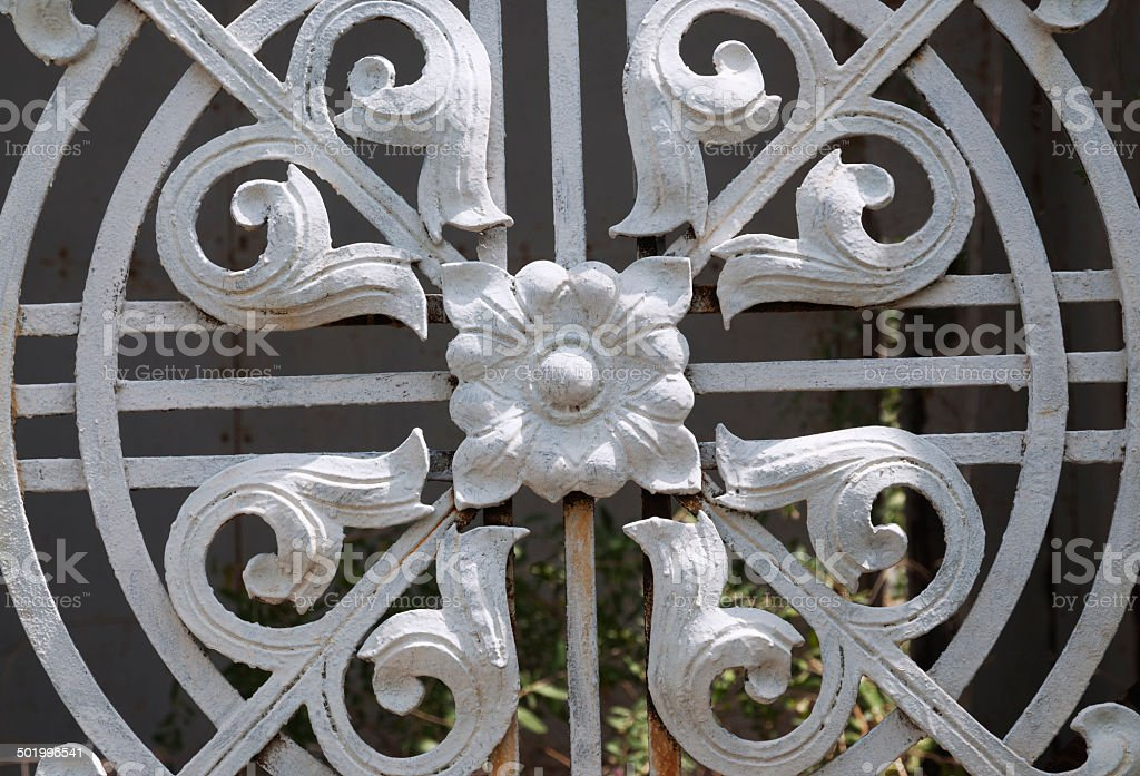 Decorative element on the gates of  old chapel stock photo