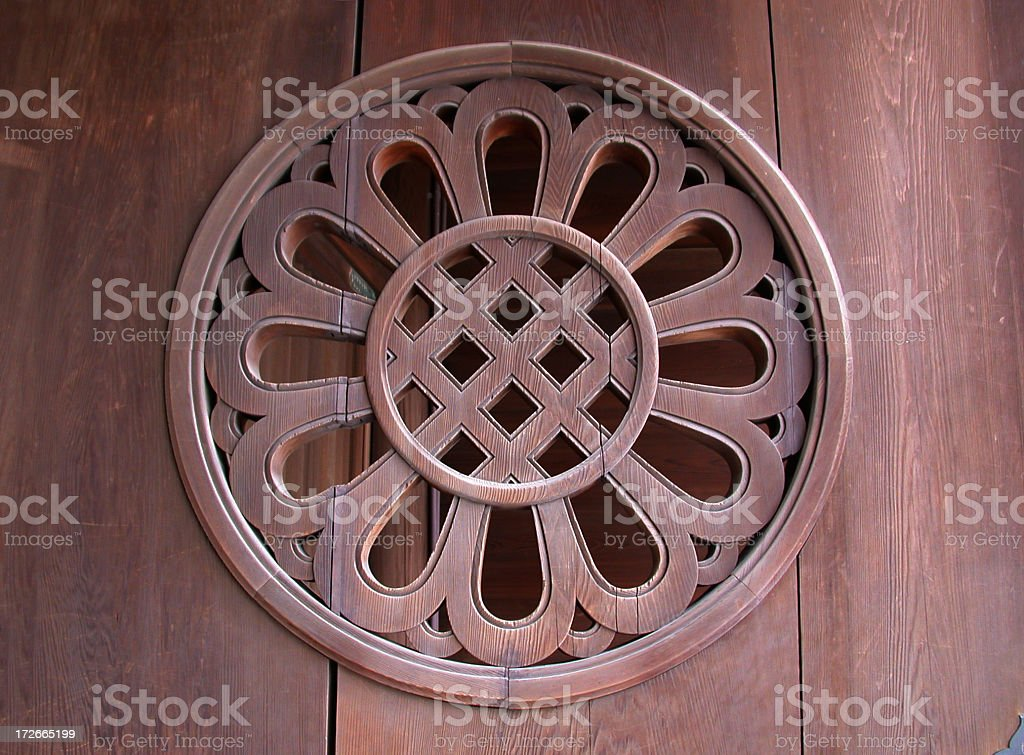 decorative element on wooden door stock photo