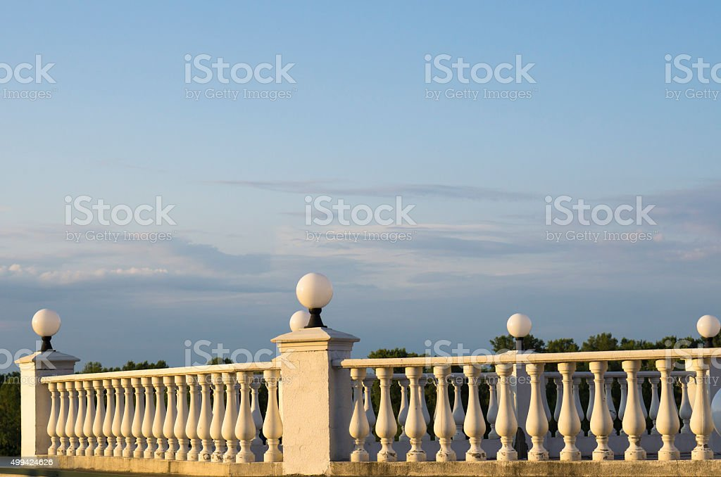 Decorative fence of columns on promenade on background of sky stock photo