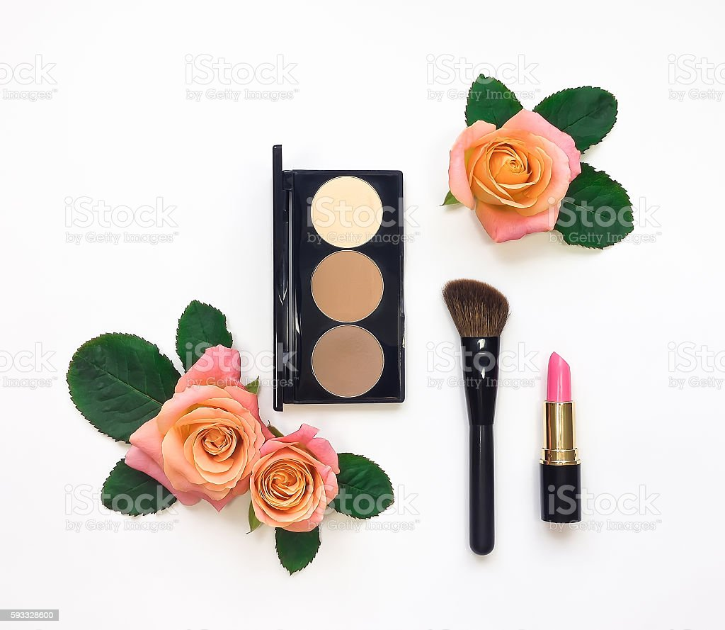 Decorative flat lay composition with cosmetics and flowers. Flat lay stock photo