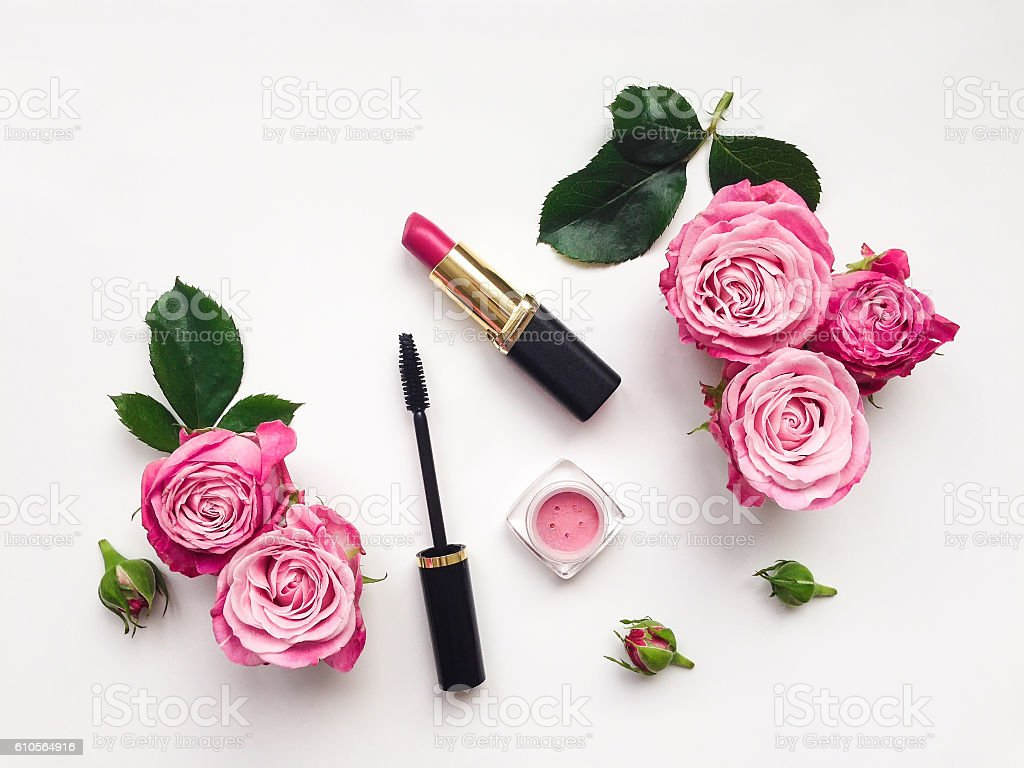 Decorative flat lay composition with cosmetics and flowers stock photo