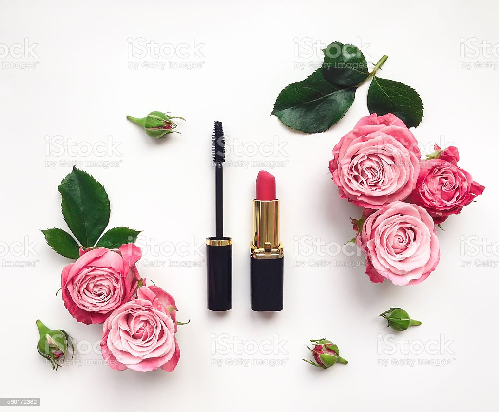 Decorative flat lay composition with cosmetics and flowers. Top view stock photo