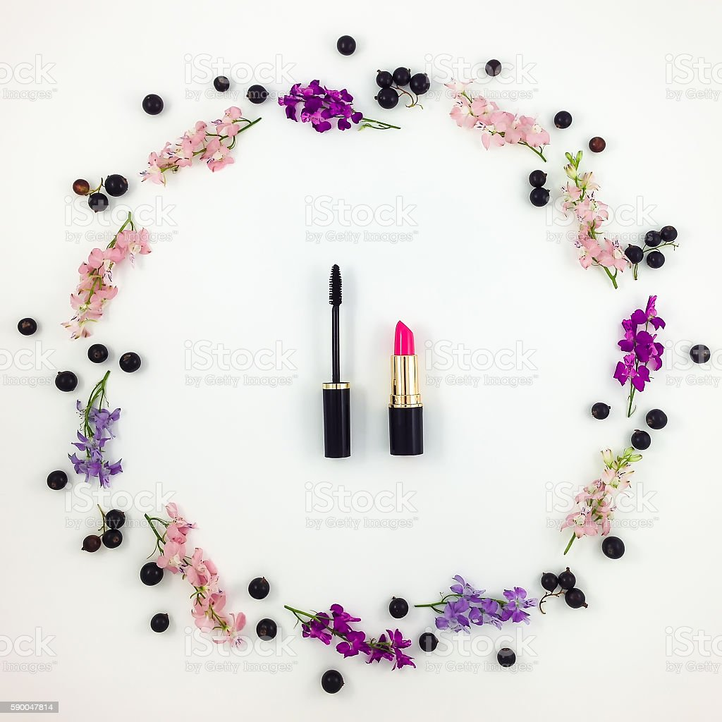 Decorative flat lay composition with cosmetics, flowers and berries stock photo