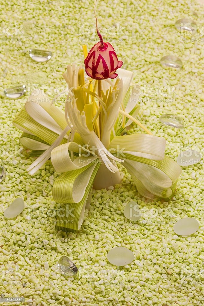 Decorative flower of leeks and radishes royalty-free stock photo