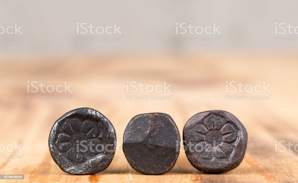 Decorative forged nails stock photo