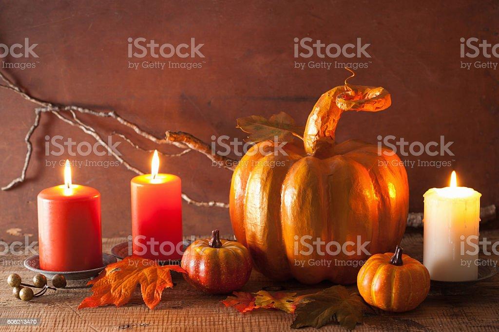 decorative golden papier-mache pumpkin and autumn leaves for hal stock photo