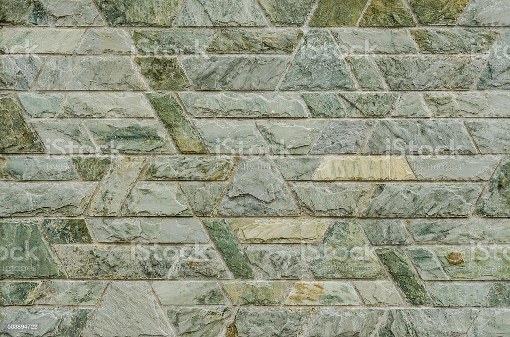 decorative green slate stone wall surface stock photo