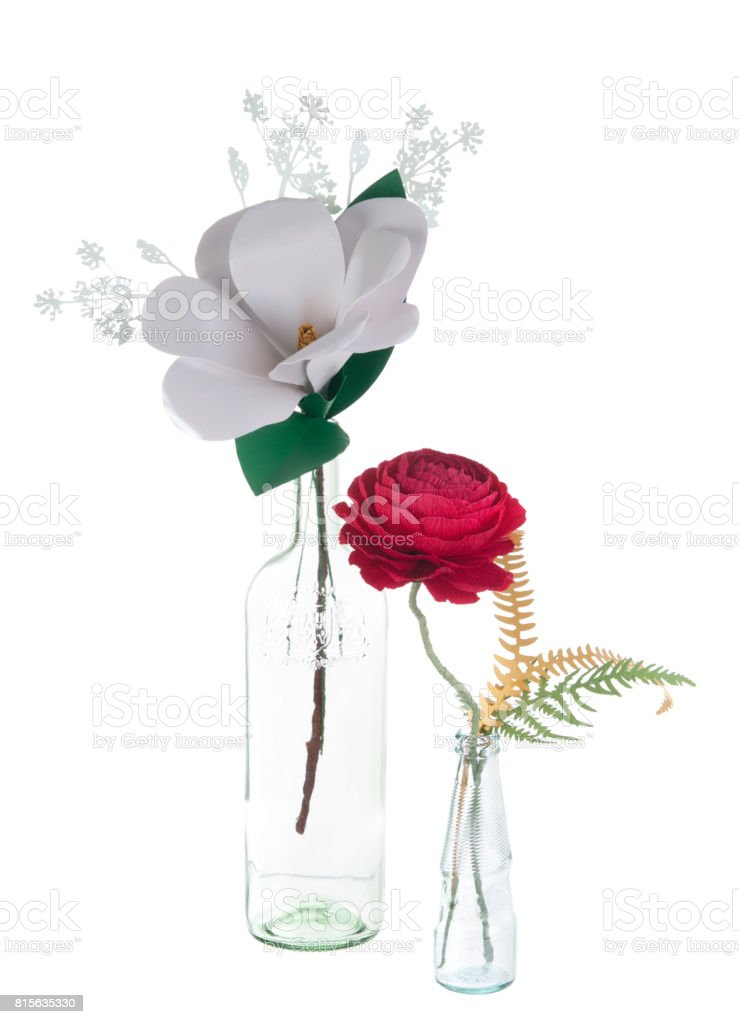 decorative hand made paper white magnolia and red rose flowers in vases stock photo