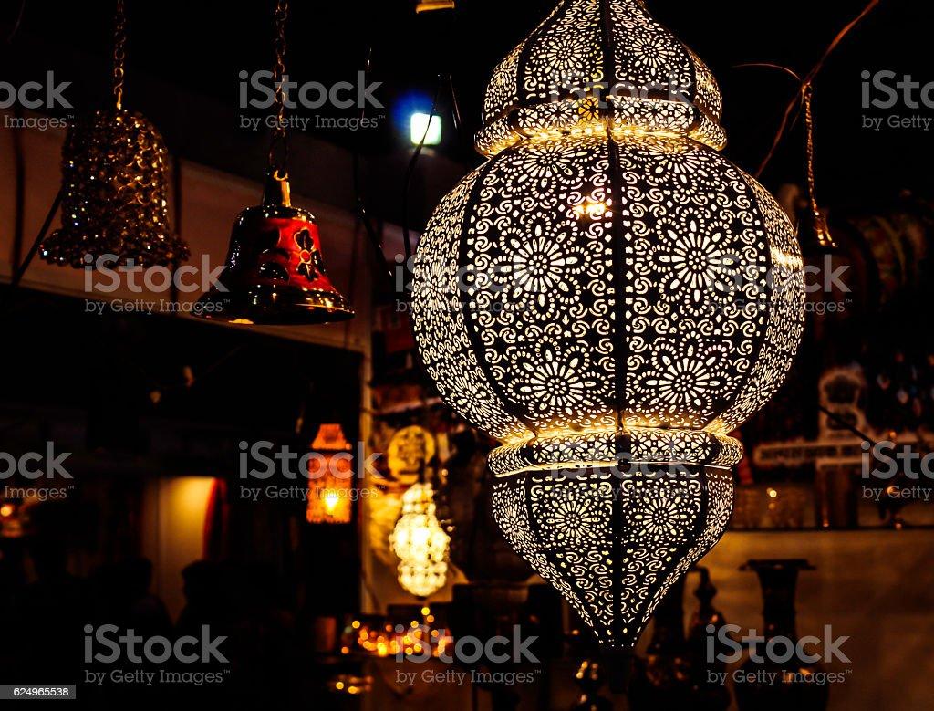 Decorative hanging lamp illuminating stock photo