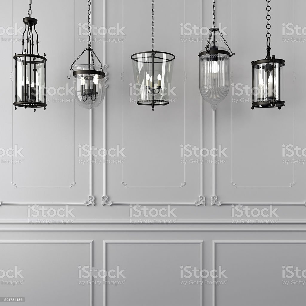 Decorative hanging lamps against a white wall stock photo