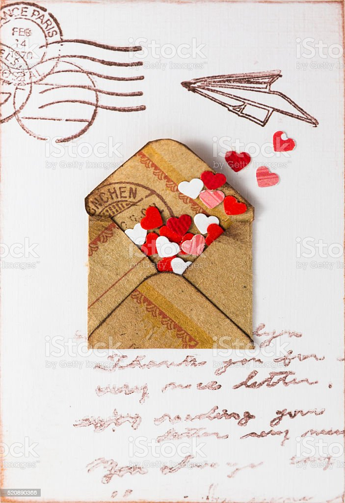 Decorative hearts are in a old postal envelope stock photo