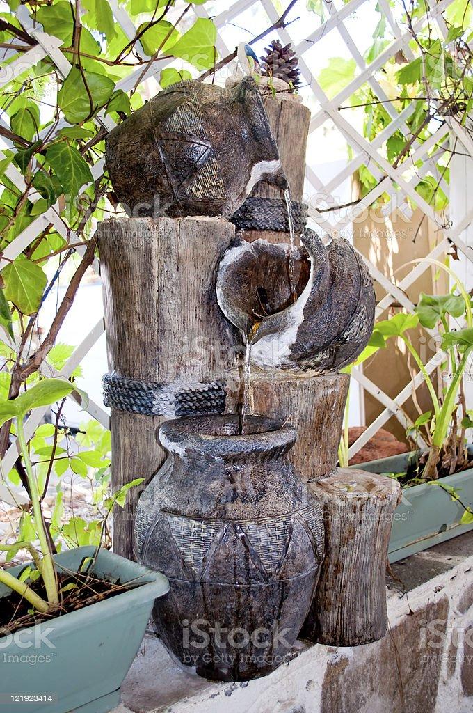Decorative jar fountain stock photo