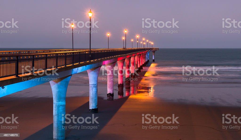 Decorative lighting of a pier at twilight stock photo