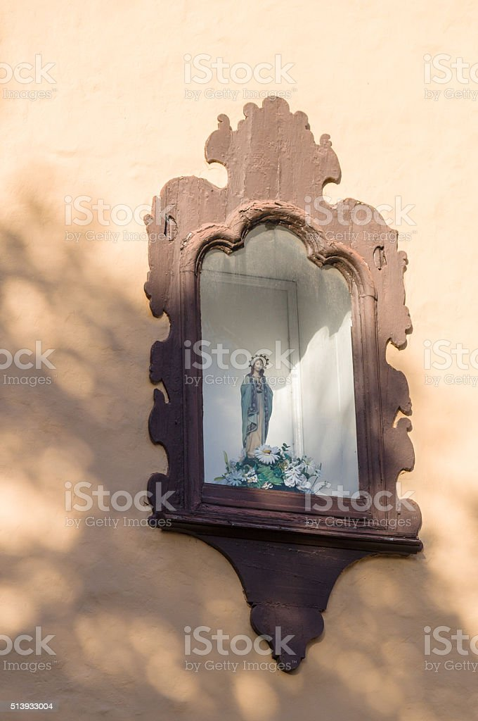 Decorative niche in the wall with religious sculpture stock photo