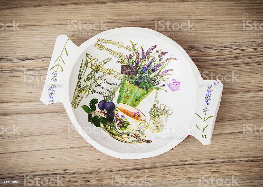 Decorative painted bowl on the wooden background, Easter stock photo