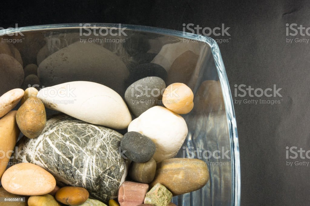 decorative pebbles in glass containers stock photo