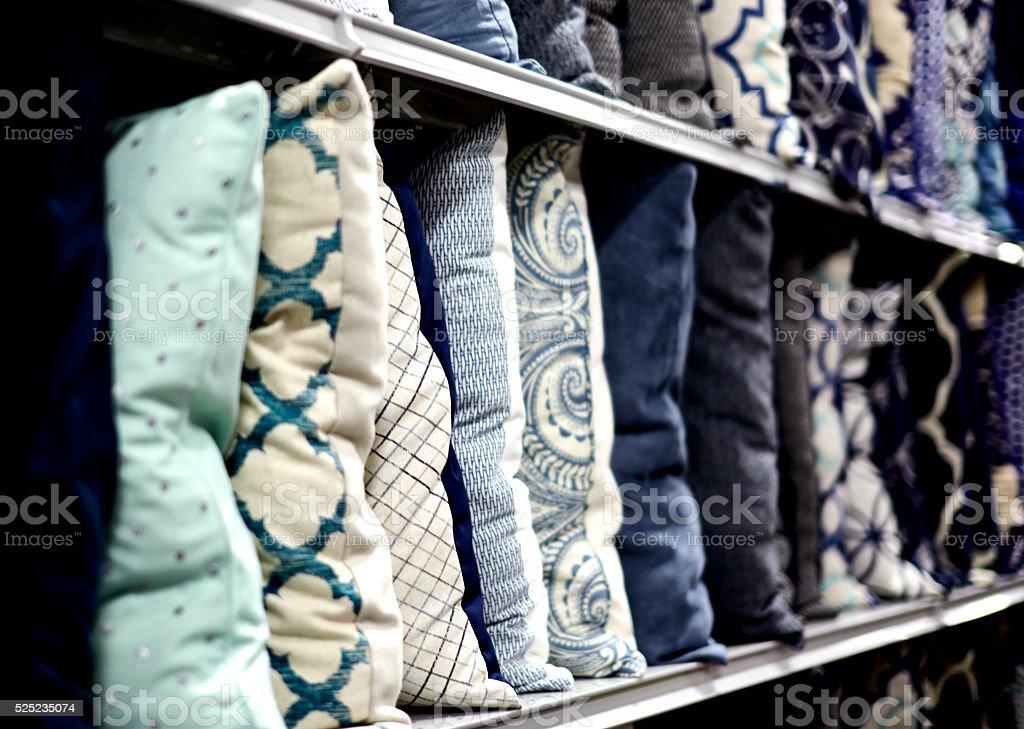 Decorative Pillows on a Shelf stock photo