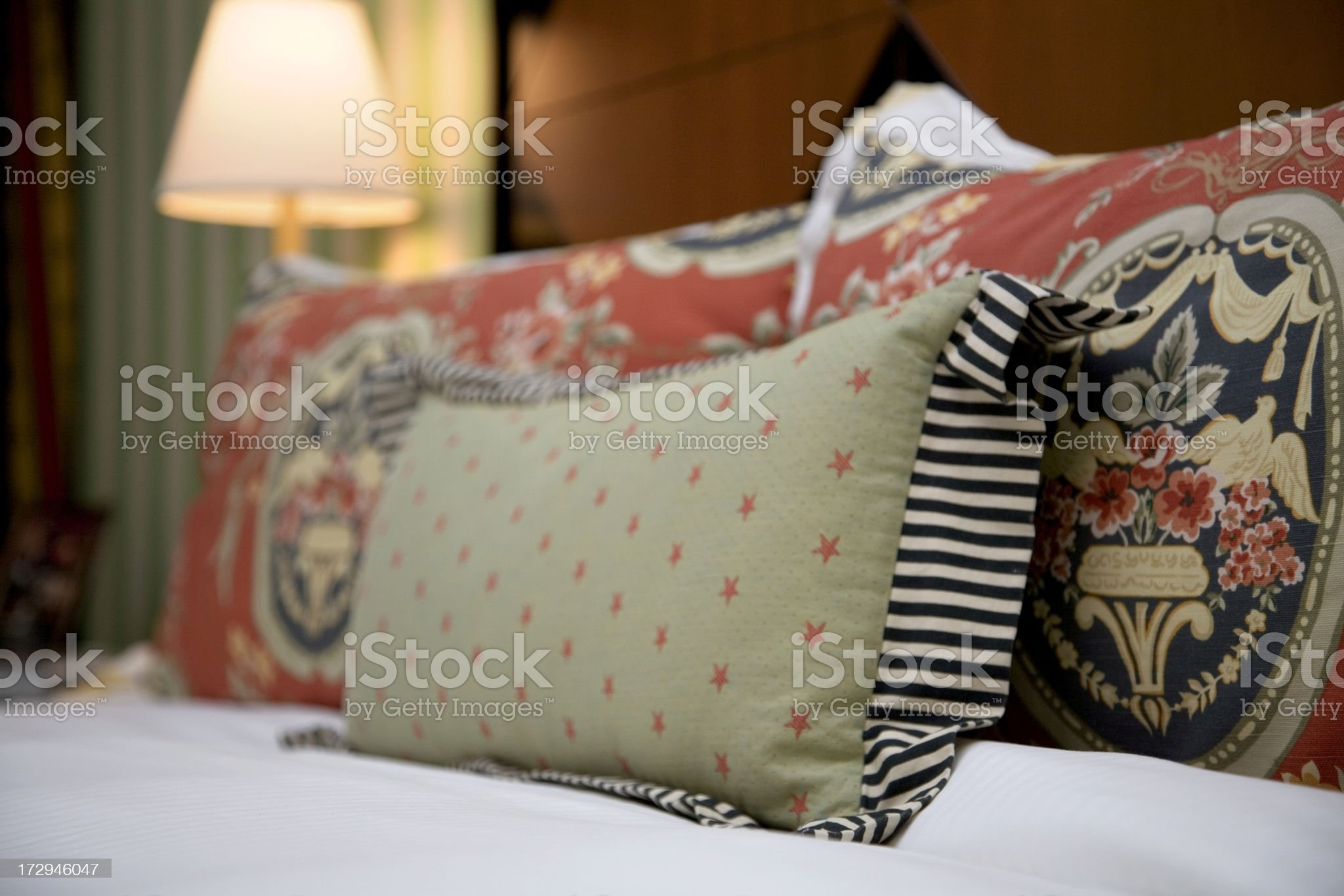 Decorative Pillows on Bed in Luxury Hotel Room royalty-free stock photo