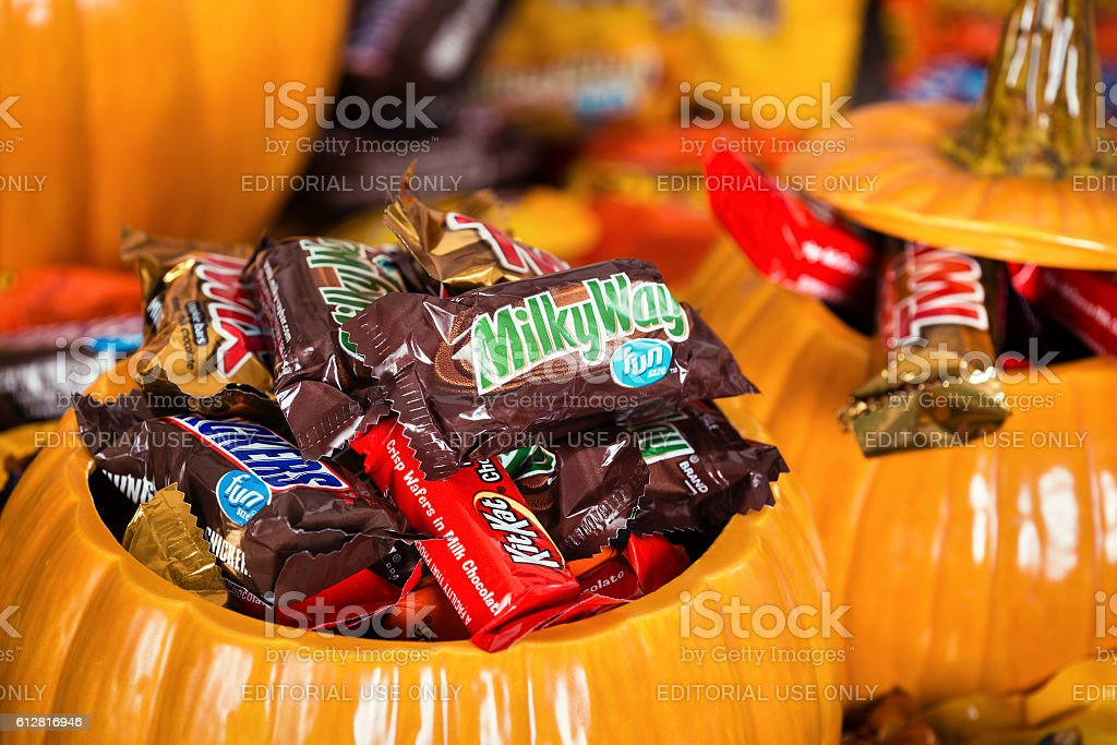Decorative pumpkins filled with Halloween candy stock photo