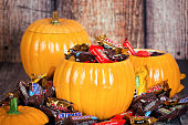 Decorative pumpkins filled with Halloween candy