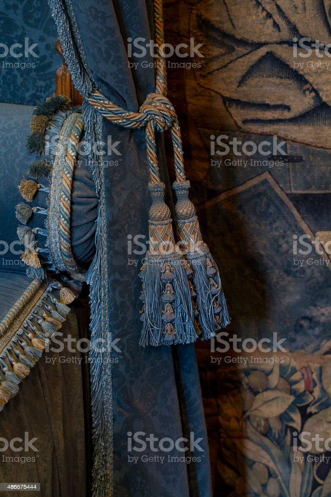 Decorative renaissance style blue bed and curtain fabric stock photo