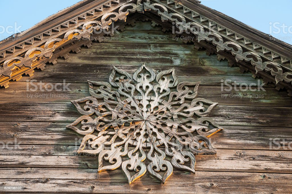 Decorative rosace on the fronton of  old Russian wooden house stock photo