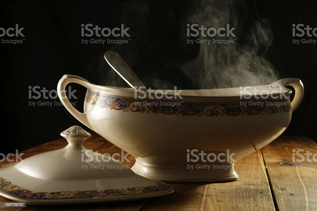 Decorative soup bowl filled with soup stock photo