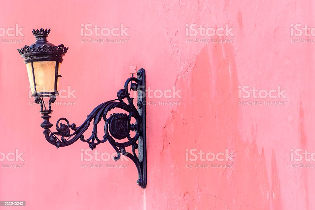 Decorative street lamp on an old colorful building. stock photo