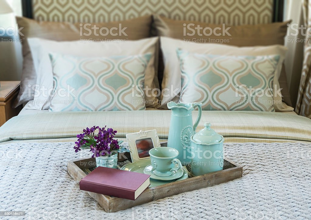 Decorative tray with book,tea set and flower stock photo