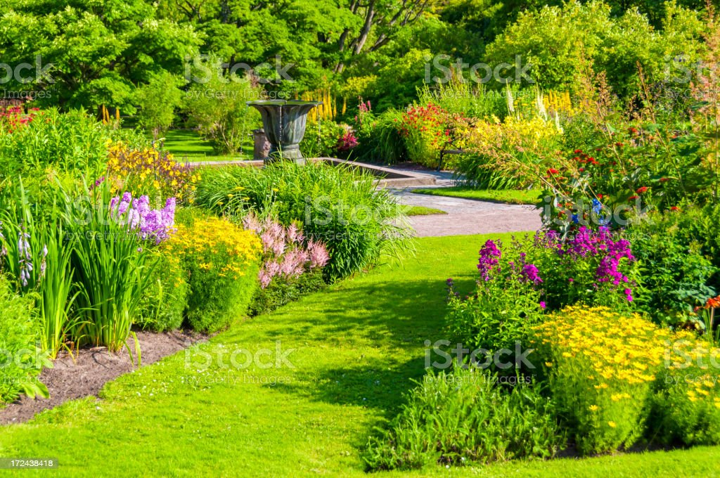 Decorative Urn in lavish garden stock photo