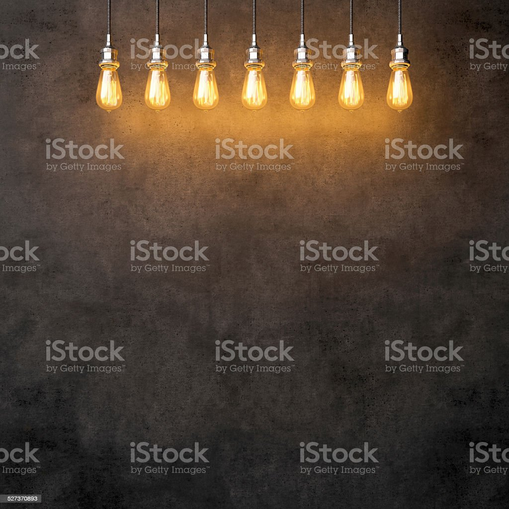 Decorative vintage lightbulbs on dark concrete background stock photo