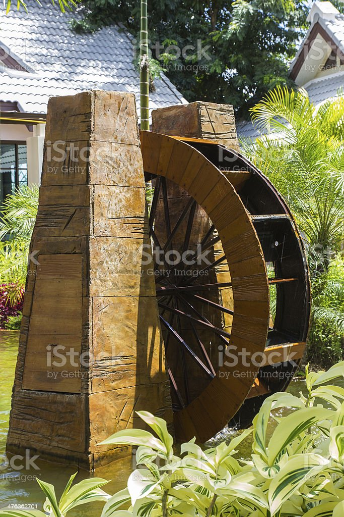 Decorative water wheel in the garden, element of modern royalty-free stock photo