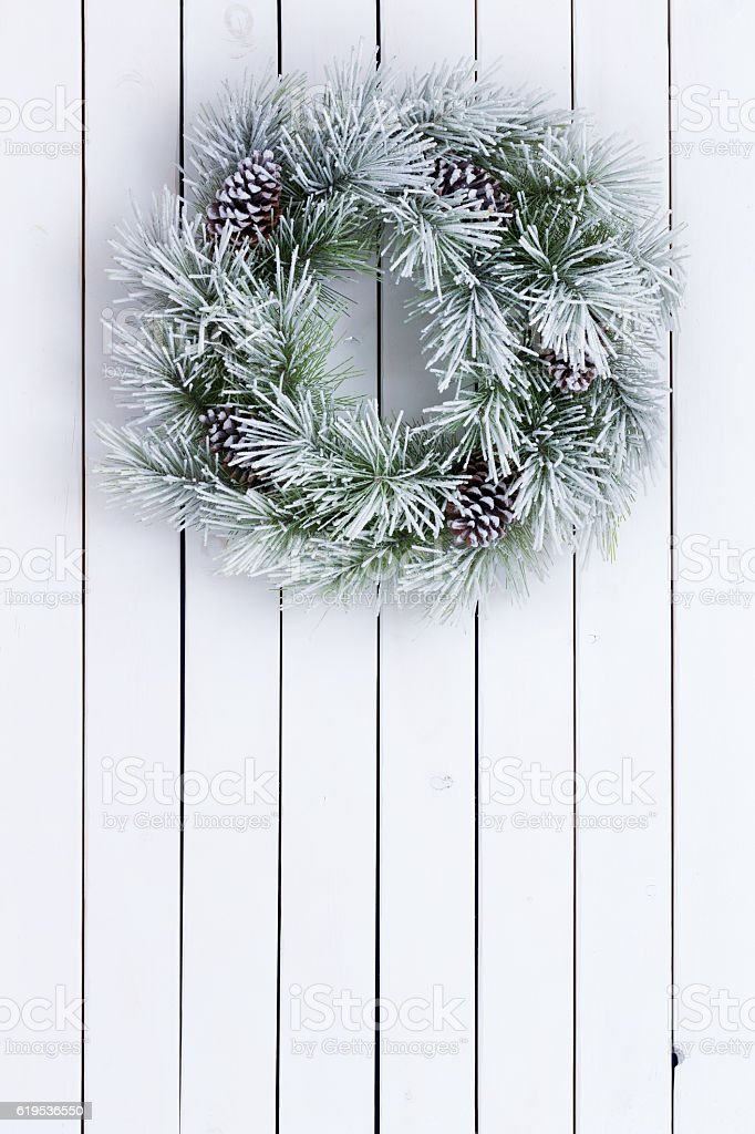 Decorative white stained green Christmas wreath stock photo